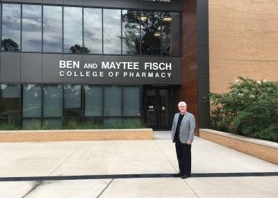 Don Bristow outside the Ben and Maytee Fisch College of Pharmacy